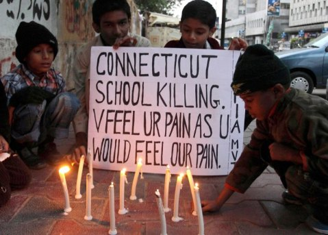 Childrenin Karachi, Pakistan hold a vigil in support for Newtown, Conn.